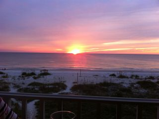 Watch breathtaking sunsets right from the balcony! - Indian Shores condo vacation rental photo