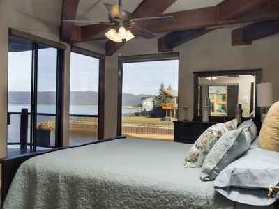 Spectacular Views of Lake in every room has a king sized bed