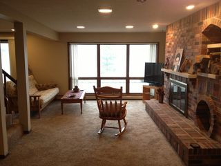 Traverse City house photo - Nice Sitting area in front of Fireplace and Looking out at the lake.