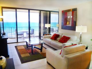 Hutchinson Island condo photo - Direct oceanfront leaving room, Natuzzi leather couches, HDTV, wireless Interne
