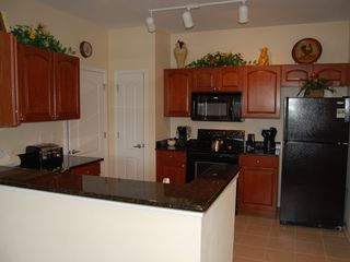 Cane Island condo photo - Condominium Full Kitchen - View 1