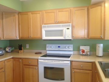 Kitchen with new appliances, dishes, glassware and utensils!