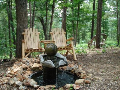 Relax on Log Bench/Table beside water fountain for birds !