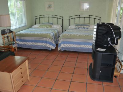Large downstairs bedroom with two Queen size beds, fold out futon and full bath