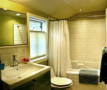 Full bathroom with jacuzzi tub & shower