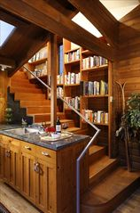 Aspen house photo - Cookbook library lines the open staircase