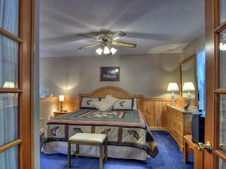 Pigeon Forge cabin photo - A bed fit for a 'King' behind French Doors....