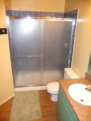 Twin Lakes condo photo - Master bathroom with walk in shower, storage, hair dryer supplied for guest use.