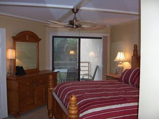 Palmetto Dunes condo photo - Master suite and entrance to balcony #1. Large dresser. King size bed. Fan.