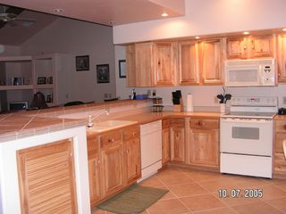 Pinetop condo photo - Kitchen is ready to serve all your meals, also Laundry Facillity inside