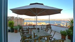 Istanbul apartment photo - dine on rooftop w Bosphorus and Old City views. Outdoor food prep area & bar