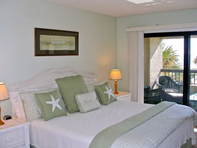 Amelia Island condo rental - King bedroom has newly installed carpet, large oceanfront verandah & TV.