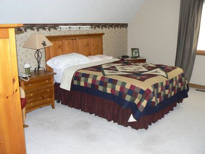 Master bedroom has queen bed & loft sitting room