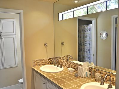 Carmel Highlands house rental - Master Bath's sinks. Shower and toilet to left. Master walk-in closet far left