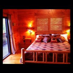 Sevierville chalet photo - Master bedroom with door to deck - king size bed and jacuzzi tub in bathroom.