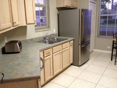 Updated kitchen is spacious and with lots of counter space.