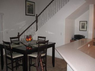 Las Vegas house photo - The kitchen table and stairs to the second floor