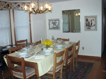 The separate dining room seats 8