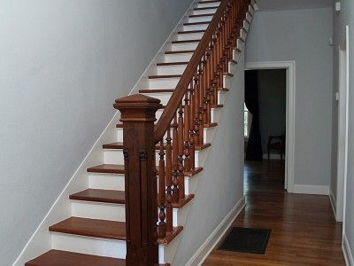 Dramatic hand crafted oak and cedar staircase entering second floor