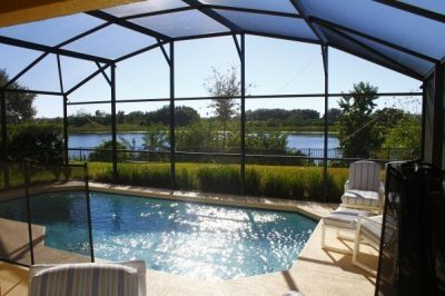 Beautiful lakeview of Lake Joe from private pool with covered Lanai