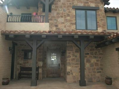 New spanish/western style home, adobe, timbers, natural stone