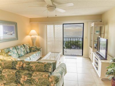 Spacious Living Room - This living room is open to double sliding doors for a maganificant view of the beach. Enjoy spending family time in here or step outside on the patio to catch the ocean breeze.
