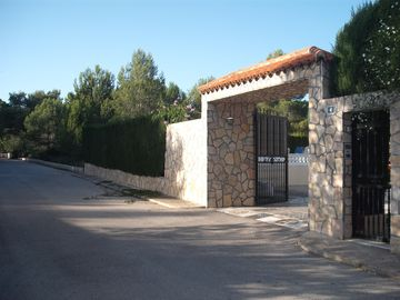 The house is gated & is located on a quiet street