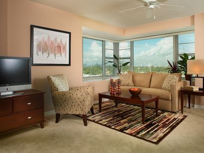 Spacious Living Area with 32 inch flat panel TV, DVD/VCR player, Sofabed, Chair