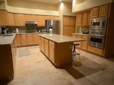 New gourmet kitchen, stainless steel appliances, including Viking Professional.