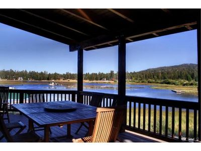 Dining table under covered area of deck with great mountain and lake views!