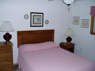 Branson townhome photo - Upper level guest room with queen bed and a bath off the hallway. French decor