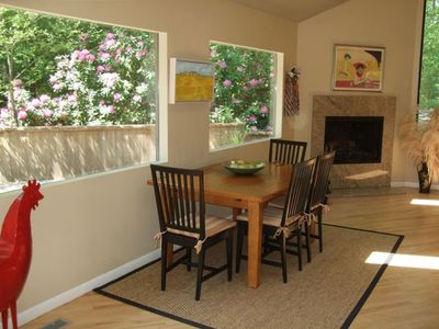 dining area with fireplace. outdoor side deck