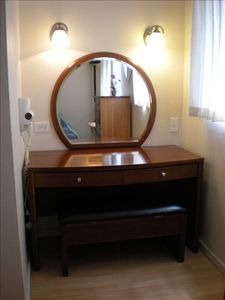 vanity with storage in top and cushioned bench seat