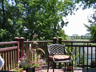 Thurmont house photo - Spacious deck overlooking meadow and forest-lovely breakfast area