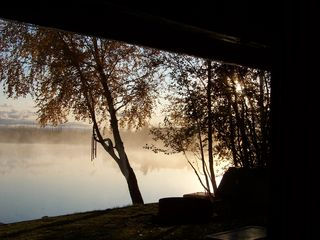 Big Lake cabin photo - Another beautiful sunrise on the covered front porch.....