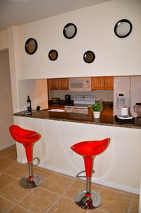 Kitchen counter with two bar stools