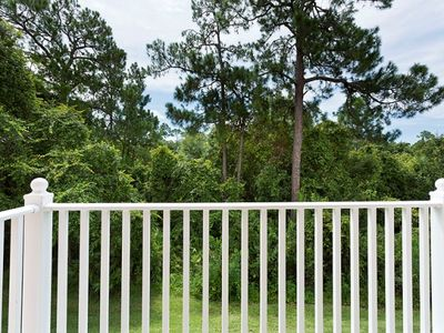 Emerald Island townhome rental - View of woodlands from master bedroom private balcony