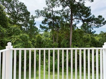 View of woodlands from master bedroom private balcony