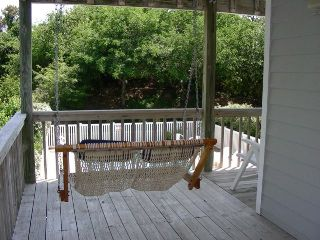 Duck house photo - Double porch swing overlooks the pool