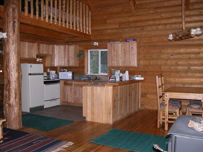 Kitchen, in addition there is a Breakfast Bar, Dining table and Wood Stove Area