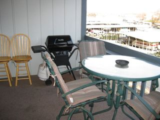 Osage Beach condo photo - Deck with chairs for 6.
