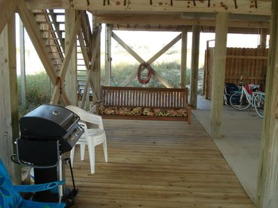 Grill area under house with deck & porch swing. Hot/cold shower.