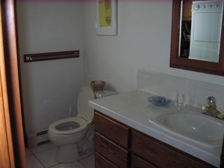 Eastham house photo - First Floor Tiled Bath and Laundry Room