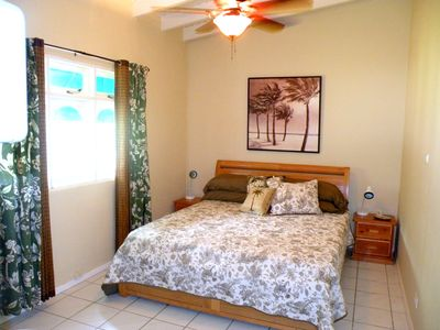 2nd bedroom includes King bed, ceiling fan, AC and garden views
