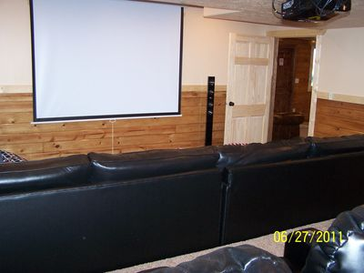 Great seating anywhere in this room w/100 inch theatre screen & surround sound