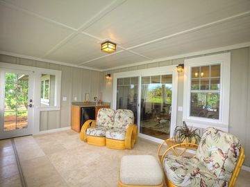 Enjoy a gentle, warm breeze on your screened lanai ...rain or shine