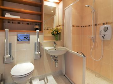 Master en-suite shower room with disabled access