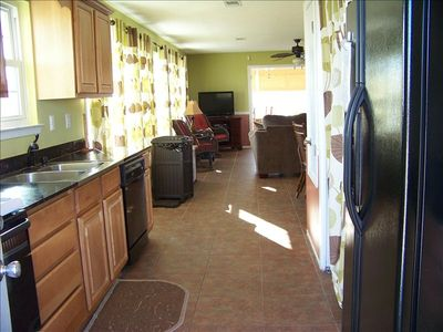 Fully Equipped Cook's Kitchen W/ Filtered Water & Ice Maker Looking Into Live Rm