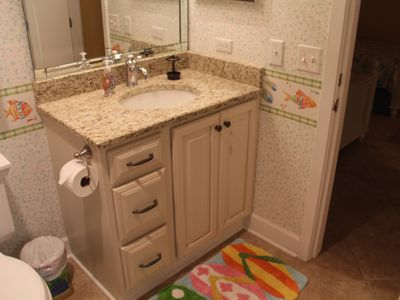 Hall bath / shower. New granite countertops, new cabinets. All new towels.