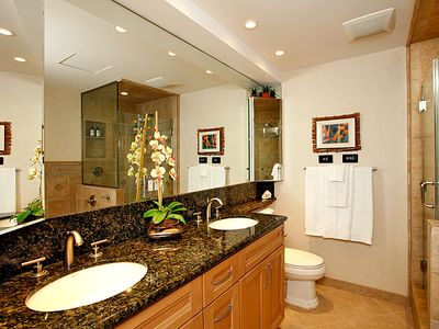 Master bath with his/her sinks and corner cabinets